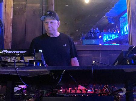 Goldman Sachs Co-President and Co-Chief Operating Officer David Solomon plays disc jockey at a lounge called Libation in New York City