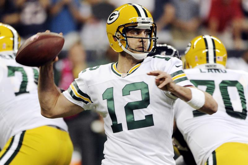 Green Bay Packers quarterback Aaron Rodgers (12) throws against the Houston Texans in the first quarter of an NFL football game, Sunday, Oct. 14, 2012, in Houston. (AP Photo/Dave Einsel)