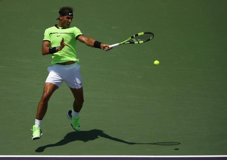 Rafael Nadal of Spain returns a shot during his 6-1, 7-5 win over Italian Fabio Fognini at the Miami Open