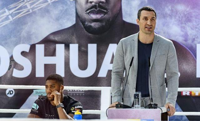 IBF heavyweight champion Anthony Joshua (L) listens as former champ Wladimir Klitschko speaks. (Getty Images)
