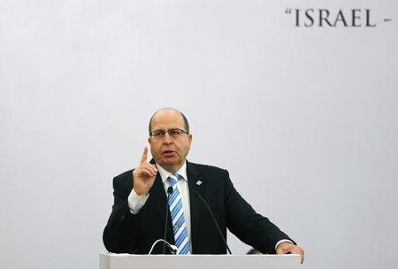 Israeli Defence Minister Moshe Ya'alon gestures while addressing a gathering during a lecture in New Delhi