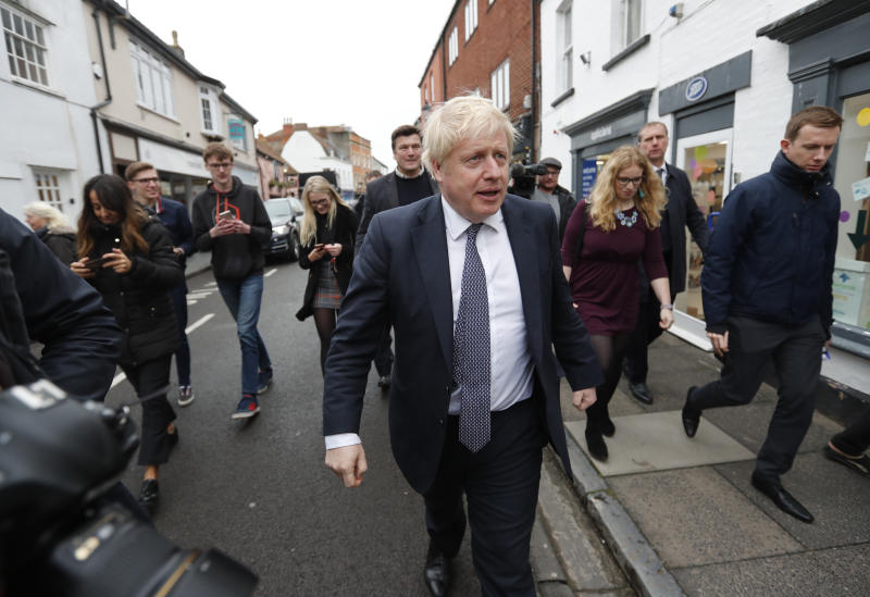 Britain's Prime Minister Boris Johnson walks through High Street during a General Election campaign trail stop in Wells, England, Thursday, Nov. 14, 2019. Britain goes to the polls on Dec. 12. (AP Photo/Frank Augstein, Pool)