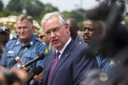 Missouri Governor Jay Nixon addresses the media in Ferguson, Missouri