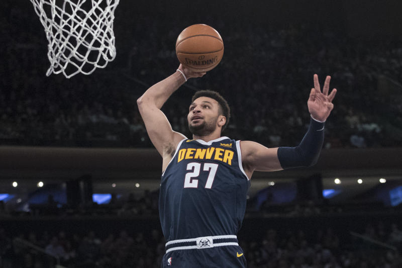 Denver Nuggets guard Jamal Murray dunks during the first half of an NBA basketball game against the New York Knicks, Friday, March 22, 2019, at Madison Square Garden in New York. (AP Photo/Mary Altaffer)