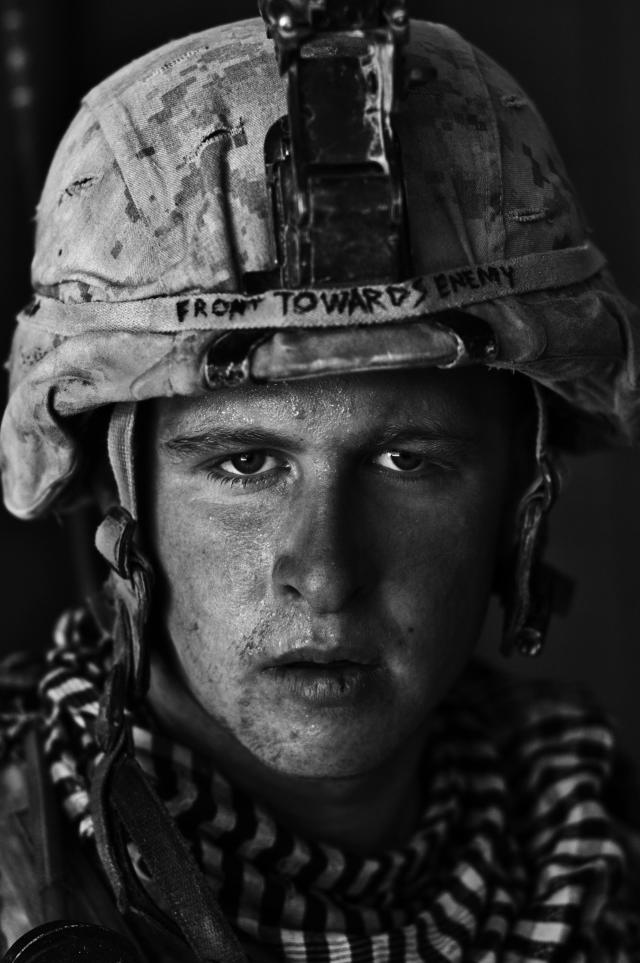 "<p>""Home Front"": U.S. Marine Lt. Cpl. Damon ""Commie"" Connell, 20, after a patrol in Garmsir District, Helmand Province, Afghanistan, at Forward Operating Base Apache North. Damon is from Las Vegas, and this was his first tour of Afghanistan. (© Louie Palu/ZUMA Press from ""War Is Only Half the Story,"" the Aftermath Project & Dewi Lewis Publishing) </p>"