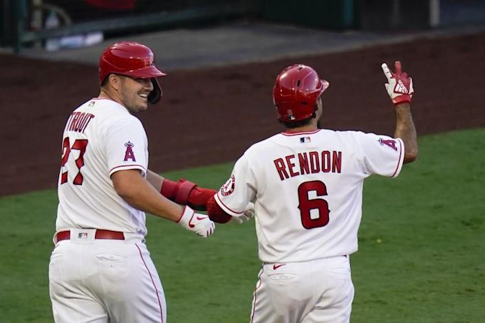 """Anthony Rendon, right, celebrates with teammate Mike Trout after hitting a two-run home run against the Oakland Athletics on Monday. <span class=""""copyright"""">(Jae C. Hong / Associated Press)</span>"""