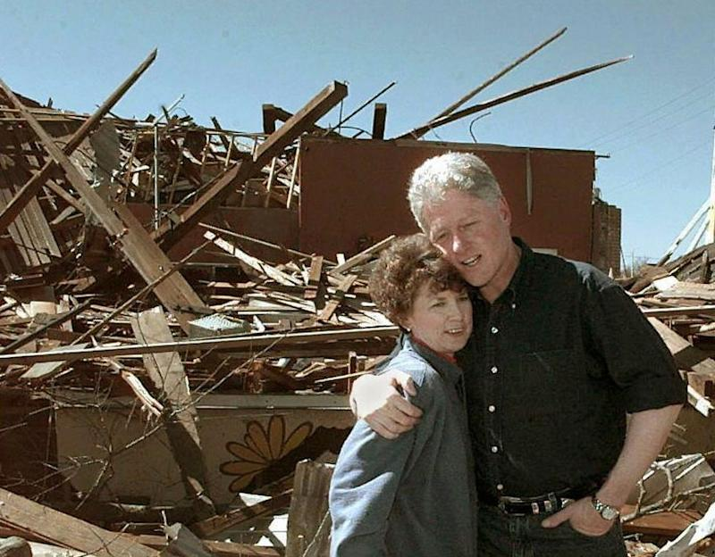 Bill Clinton surveying damage from a series of 2004 tornados in Arkadelphia, Arkansas. (JOYCE NALTCHAYAN via Getty Images)