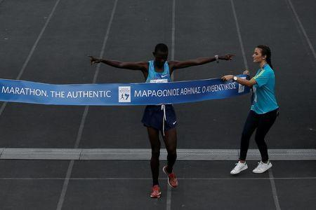 FILE PHOTO - Athletics - Athens Marathon - Athens, Greece - November 12, 2017 - Kenyan Samuel Kalalei reacts while finishing first in the Athens Marathon Men's race. REUTERS/Alkis Konstantinidis