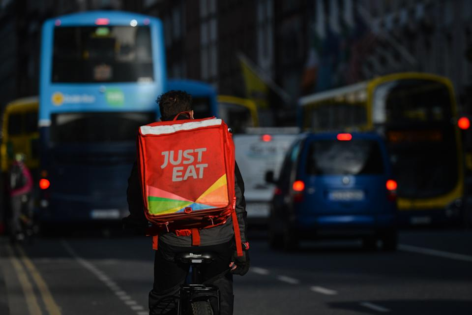 A Just Eat currier seen in Dublin city center during Level 5 Covid-19 lockdown. On Thursday, March 25, 2021, in Dublin, Ireland. (Photo by Artur Widak/NurPhoto via Getty Images)