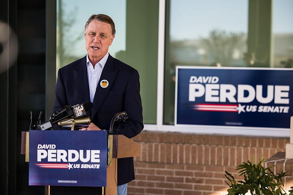 Senator David Perdue speaks during a campaign stop at the Savannah/Hilton Head International Airport on Monday. Early voting kicked off today for the January 5th runoff election.
