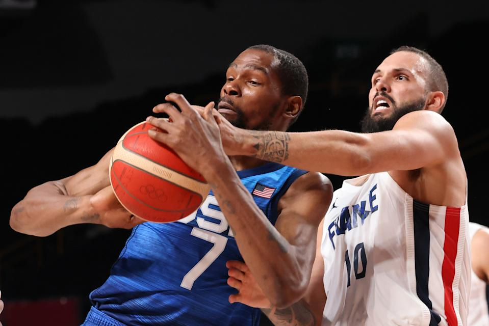 Tokyo, Japan, Sunday, July 25, 2021 - TTeam France shooting guard Evan Fournier (10) knocks the ball from Team United States forward Kevin Durant (7) in the second half at Saitama Super Arena.  (Robert Gauthier/Los Angeles Times via Getty Images)