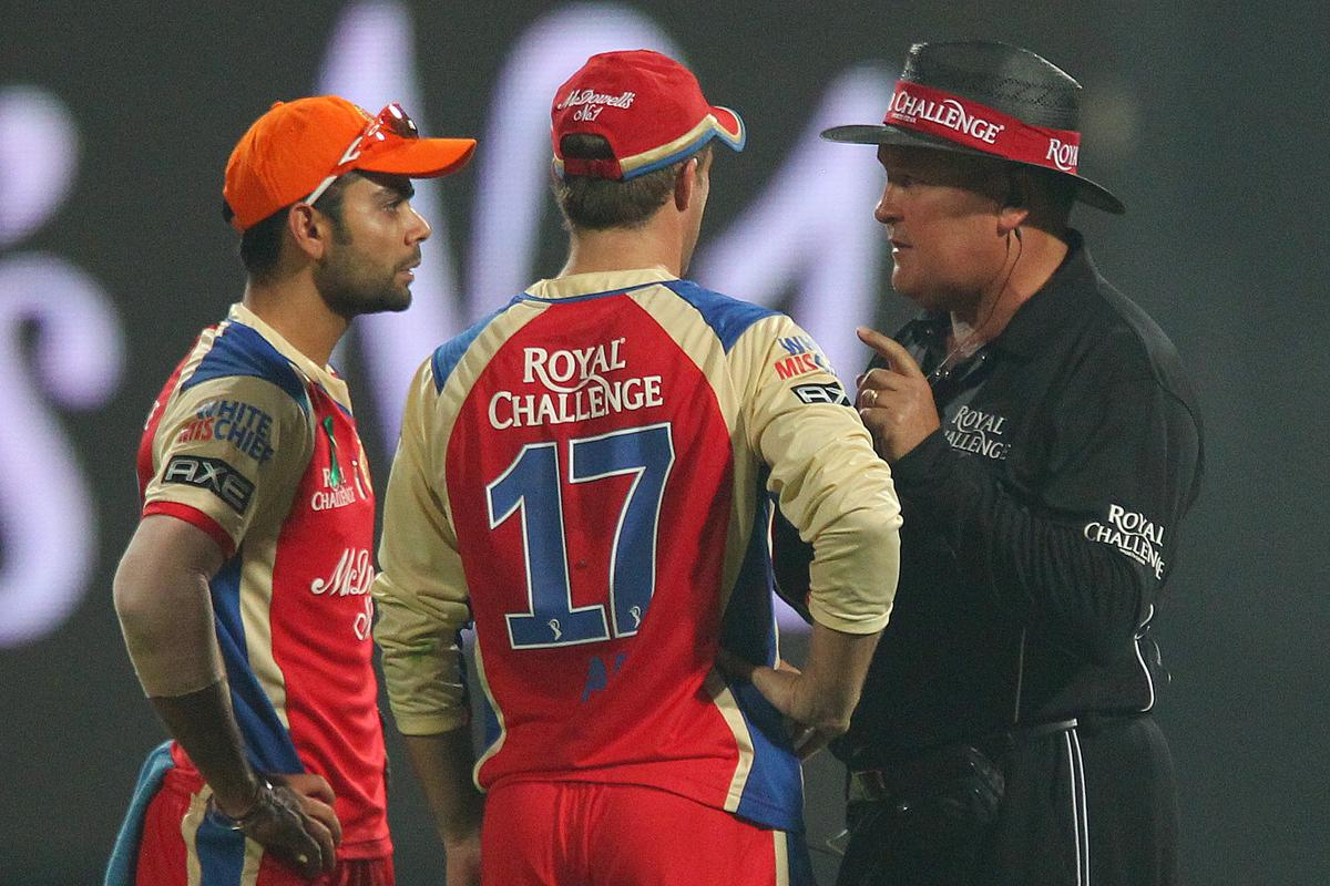 Umpire Marais Erasmus has a word with Virat Kohli and AB de Villiers during match 21 of the Pepsi Indian Premier League between The Royal Challengers Bangalore and The Delhi Daredevils held at the M. Chinnaswamy Stadium, Bengaluru  on the 16th April 2013..Photo by Ron Gaunt-IPL-SPORTZPICS ...Use of this image is subject to the terms and conditions as outlined by the BCCI. These terms can be found by following this link:..https://ec.yimg.com/ec?url=http%3a%2f%2fwww.sportzpics.co.za%2fimage%2fI0000SoRagM2cIEc&t=1503323623&sig=bn9ehPJPaSeqkN2GJlJ7vg--~D