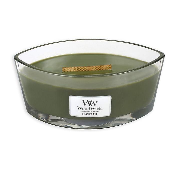 <p>Just like its namesake, the candle had a wooden wick. As intriguing as it looked, the reasoning behind it was genius. Wooden wicks mimic the sound of firewood crackling. I cannot tell you how mindblown I was, I had to try the <span>WoodWick® Frasier Fir Oval Jar Candle</span> ($30) out immediately. It transformed the atmosphere into a relaxing zone. The scents are divine, the golden hue created a tranquil environment, and the crackling was the ASMR my cozy season was missing. One product satisfying three out of the five senses at $30 is a steal. </p>