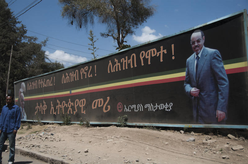 """In this Friday Feb. 22, 2013 photo, a large bill board of late Prime Minister Meles Zenawi which reads in Amharic """"He was born for the people , he lived for the people, he died for the people. Great Ethiopian leader your vision will remain the national treasure. Hero will never die, we love you """" on one of the streets in Addis Ababa. If you look around Ethiopia's capital, it would be hard to know that Meles Zenawi died six months ago. His pictures are posted everywhere and his successor is vowing to implement his vision without any alternations. Ethiopian leaders are having a hard time moving past Meles, a man who ruled this country for two decades. (AP Photo/Elias Asmare)"""