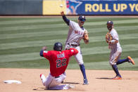 Houston Astros shortstop Carlos Correa (1) throws to first on a double play with Minnesota Twins first baseman Miguel Sano (22) out at second and Astros' Jose Altuve (27) backing up in the fourth inning of a baseball game, Sunday, June 13, 2021, in Minneapolis. (AP Photo/Andy Clayton-King)