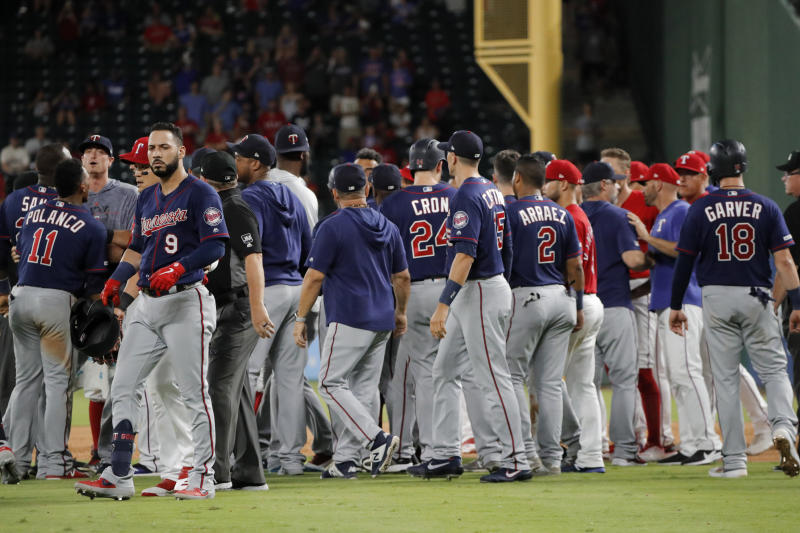 Minnesota Twins' Marwin Gonzalez (9) walks away after both benches cleared following an exchange between Gonzalez and Texas Rangers' Shawn Kelley during the eighth inning of a baseball game in Arlington, Texas, Saturday, Aug. 17, 2019. (AP Photo/Tony Gutierrez)
