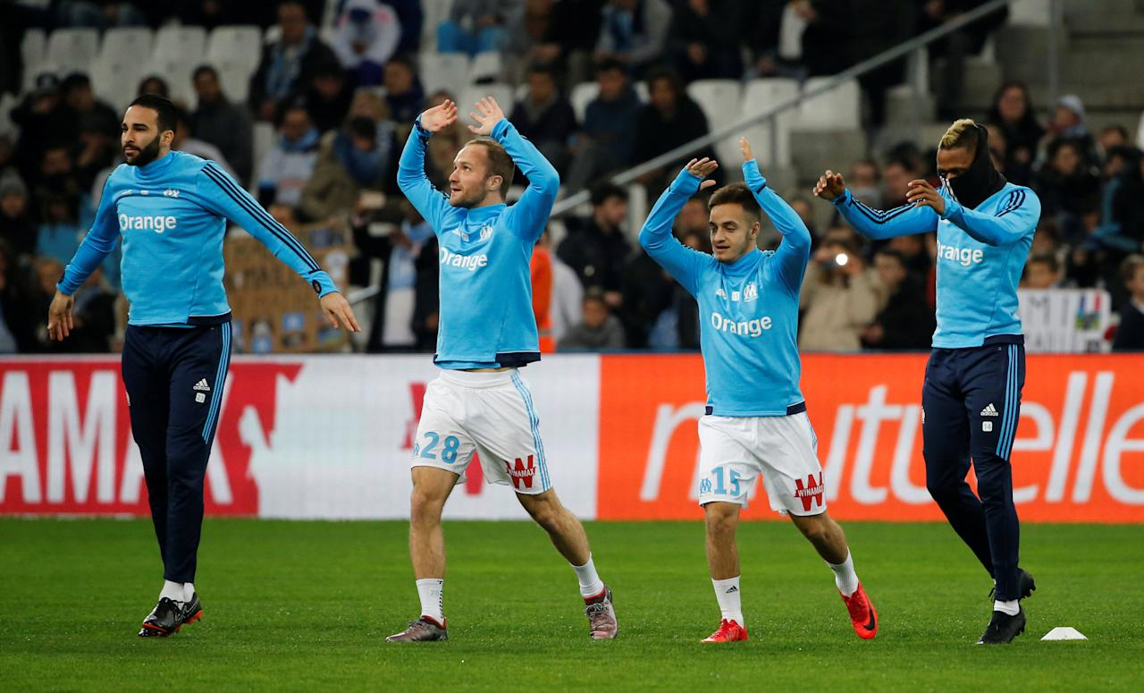 Soccer Football - Ligue 1 - Olympique de Marseille vs Bordeaux - Orange Velodrome, Marseille, France - February 18, 2018   Marseille's Adil Rami, Valere Germain, Yusuf Sari and Clinton N'Jie warm up before the game   REUTERS/Jean-Paul Pelissier