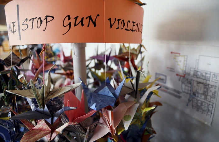 Paper cranes hang in the Columbine High School library in suburban Denver on Saturday, March 23, 2019. Several survivors and family members of the victims gathered at the library to speak about the upcoming 20th anniversary of the April 20, 1999, attack that killed 12 students and a teacher. (AP Photo/Thomas Peipert)