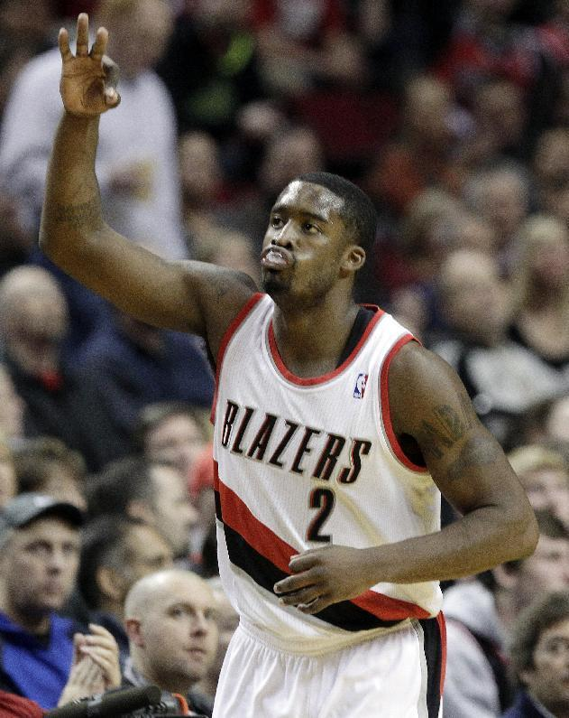 Portland Trail Blazer guard Wesley Matthews celebrates sinking a three-point shot during the first half of an NBA basketball game against the Chicago Bulls in Portland, Ore., Friday, Nov. 22, 2013. (AP Photo/Don Ryan)