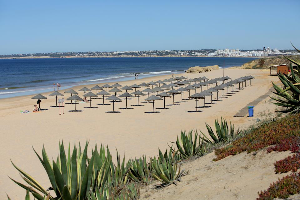 <p>Many Brits have flocked to Portugal which is on the green list (pictured is Gale beach in Albufeira)</p> (AP)