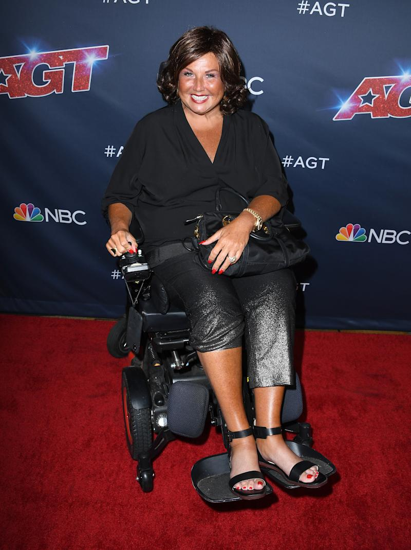 """A photo of Abby Lee Miller using a wheelchair on the red carpet at the America's Got Talent"""" Season 14 Live Show Red Carpet at Dolby Theatre on September 03, 2019 in Hollywood, California."""
