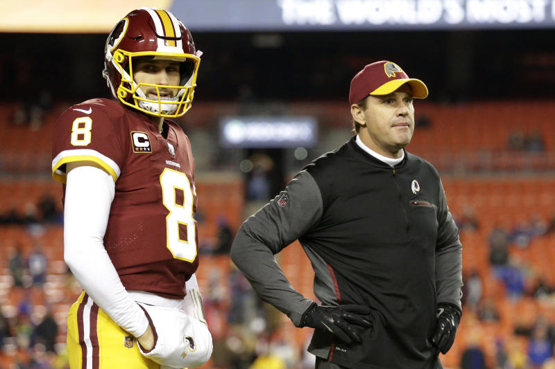 Former Redskins quarterback Kirk Cousins (8) and coach Jay Gruden before a game last season. (AP)