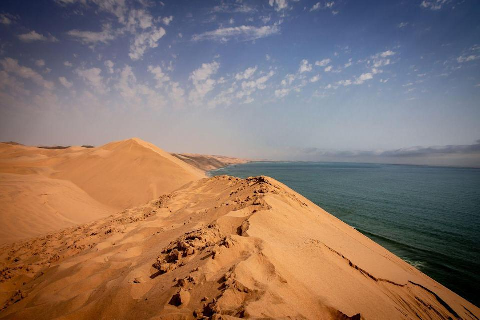 <p>The massive sand dunes alone are reason to book a trip to Walvis Bay. But you'll also want to come to this beach on Namibia's Skeleton Coast for the wildlife—you're likely to spot flamingos, seals, whales and even hyenas here.</p>