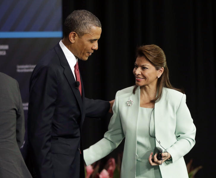 U.S. President Barack Obama, left, and Costa Rica's President Laura Chinchilla, right, talk at the conclusion of a forum on Inclusive Economic Growth and Development at the Old Custom House in San Jose, Costa Rica, Saturday, May 4, 2013. Obama, concluding a three-day visit to Mexico and Costa Rica, is cheering Mexican economic advances and pressing other Central American leaders to deal with poverty and security, while reaching out to a politically powerful Latino audience back home. (AP Photo/Pablo Martinez Monsivais)