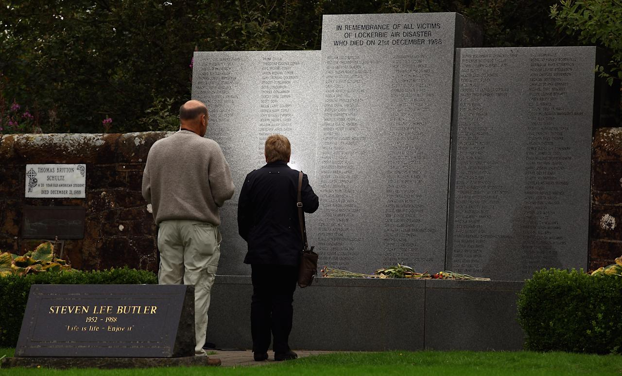 LOCKERBIE, SCOTLAND - AUGUST 23:  Members of the public visit the Lockerbie memorial on August 23, 2011 in Lockerbie, Scotland. Scottish officials are continuing efforts to make contact with the Lockerbie bomber Abdel Basset al Megrahi, following rebel forces taking control of large parts of Tripoli after days of advances.  (Photo by Jeff J Mitchell/Getty Images)