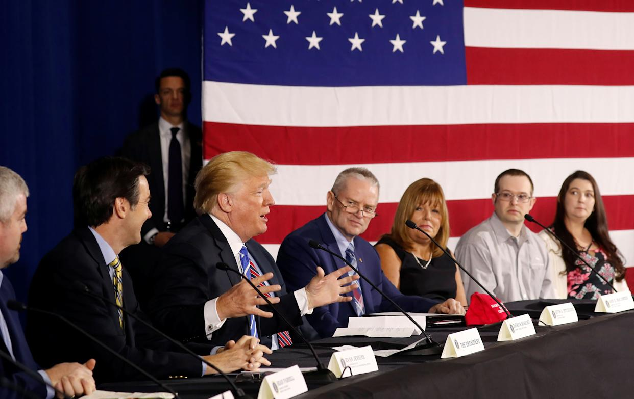 Polls show that President Donald Trump, seen here in West Virginia on Thursday, and his fellow Republicans are having a tough time selling thebenefits of their signature tax-cut legislation. (Photo: Kevin Lamarque / Reuters)