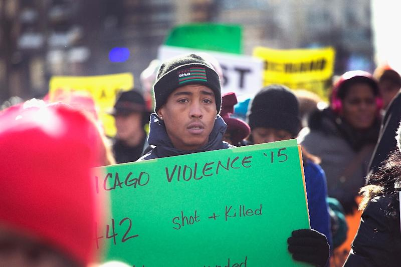 Demonstrators calling for an end to gun violence and the resignation of Chicago Mayor Rahm Emanuel march through Chicago, following the shooting deaths by police of Quintonio LeGrier and Bettie Jones (AFP Photo/Scott Olson)