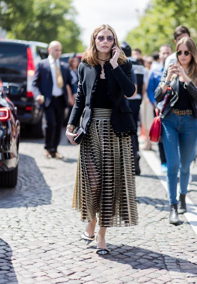 <p>Palermo wears a gold and black metallic skirt, black top, and blazer. (Photo: Getty) </p>