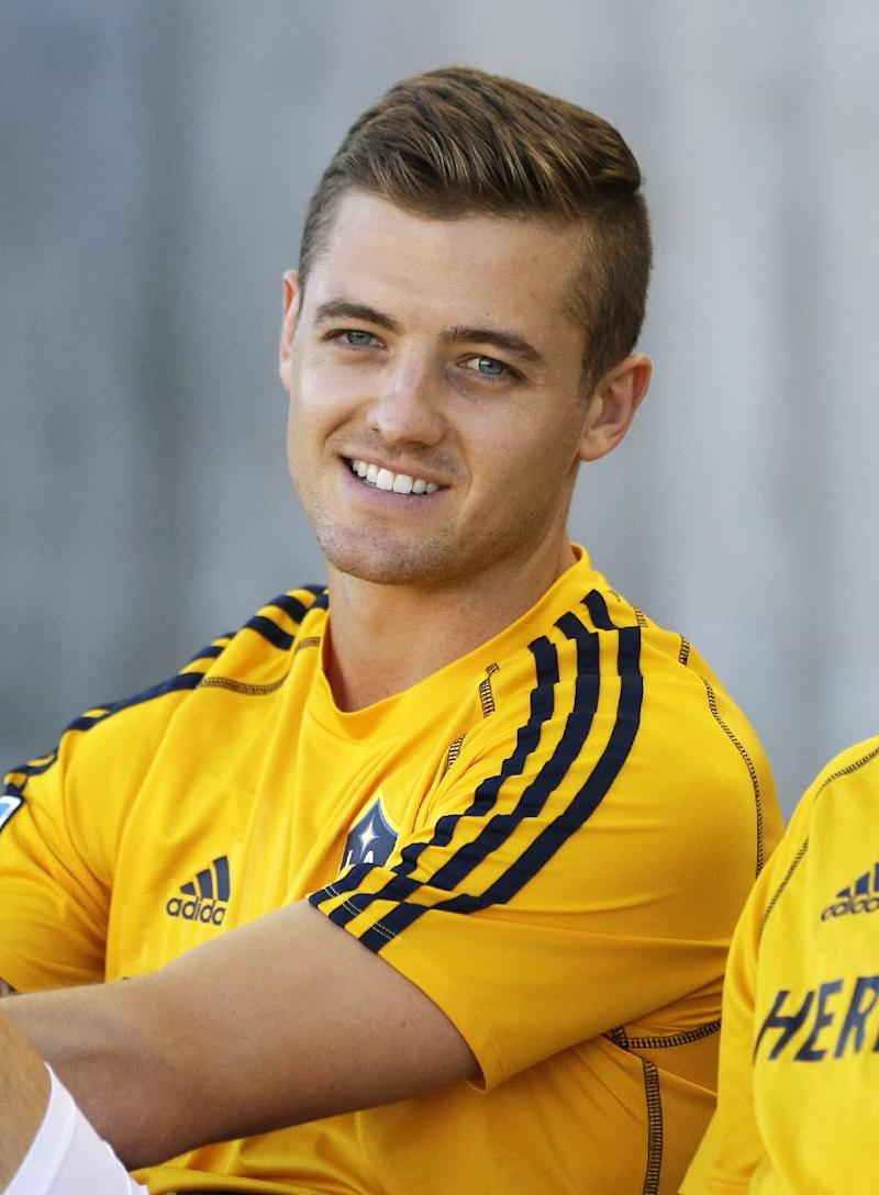 Openly gay soccer player Rogers to write memoir