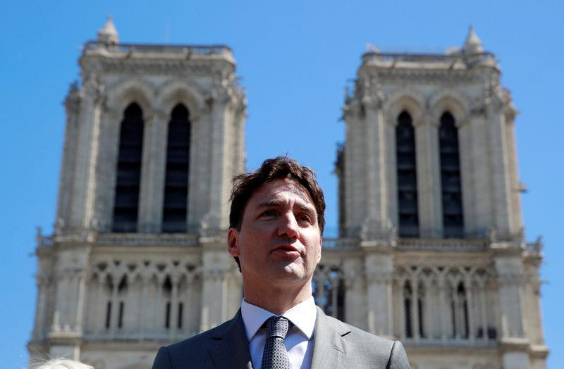 Canada's Prime Minister Justin Trudeau attends a news conference following a visit to the Notre-Dame Cathedral after a massive fire devastated large parts of the gothic structure in Paris
