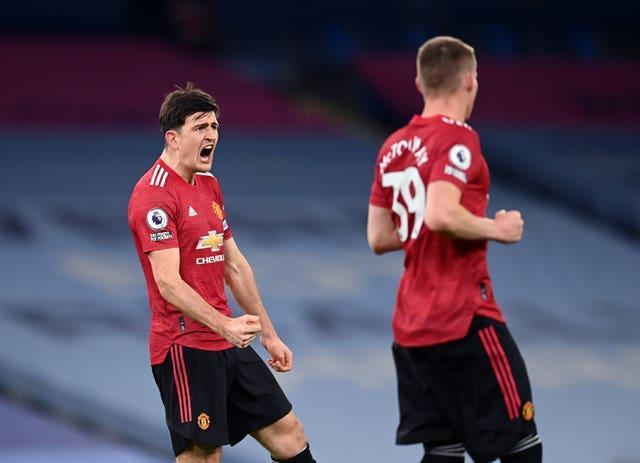 Harry Maguire (left) felt United worked hard for their win