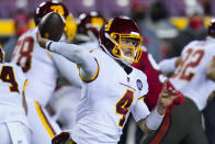 Washington Football Team quarterback Taylor Heinicke (4) throws a pass during the first half of an NFL wild-card playoff football game against the Tampa Bay Buccaneers, Saturday, Jan. 9, 2021, in Landover, Md. (AP Photo/Julio Cortez)