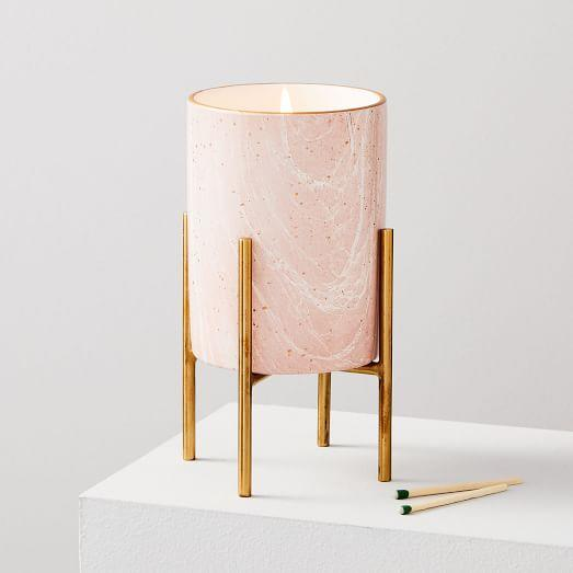 """<p><strong></strong></p><p>westelm.com</p><p><strong>$34.00</strong></p><p><a href=""""https://go.redirectingat.com?id=74968X1596630&url=https%3A%2F%2Fwww.westelm.com%2Fproducts%2Fmodern-elements-candle-on-stand-blush-e2536&sref=http%3A%2F%2Fwww.elledecor.com%2Fshopping%2Fg28470761%2Fbest-pink-candles%2F"""" target=""""_blank"""">Shop Now</a></p><p>The perfect option for creating a glam display, this candle features a blush-colored marble vessel and a striking gold stand. It's fragrance is a mix of citron, lemon blossom, magnolia, ocean breeze, sea salt, sea minerals, driftwood, and white cedar. </p>"""