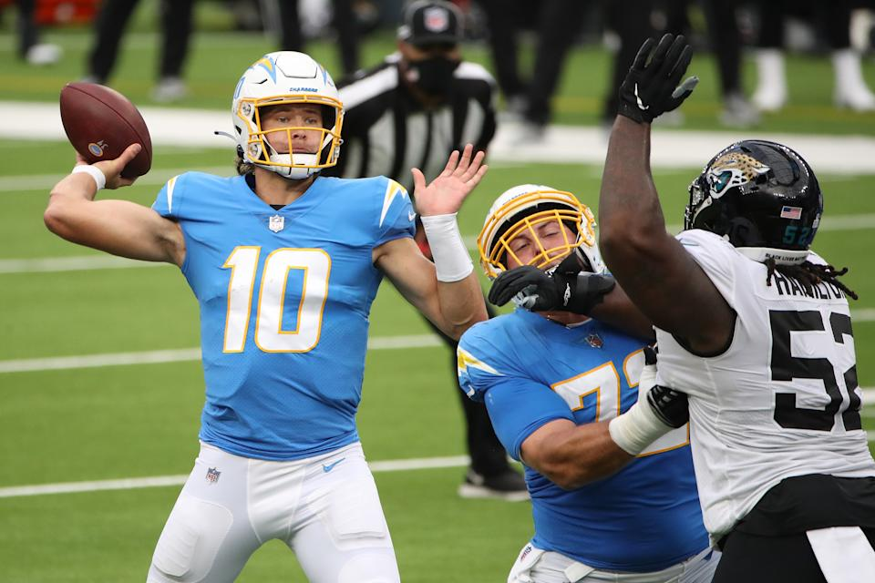 INGLEWOOD, CALIFORNIA - OCTOBER 25: Quarterback Justin Herbert #10 of the Los Angeles Chargers throws a pass against DaVon Hamilton #52 of the Jacksonville Jaguars in the second quarter at SoFi Stadium on October 25, 2020 in Inglewood, California. (Photo by Katelyn Mulcahy/Getty Images)