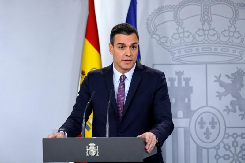 TOSpain's PM Sanchez attends a news conference after the first cabinet meeting at the Moncloa Palace in Madrid