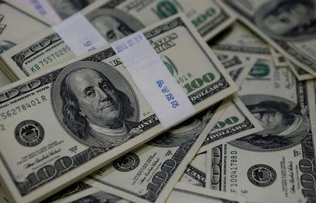 FILE PHOTO: U.S. one hundred dollar bills are seen in this picture illustration