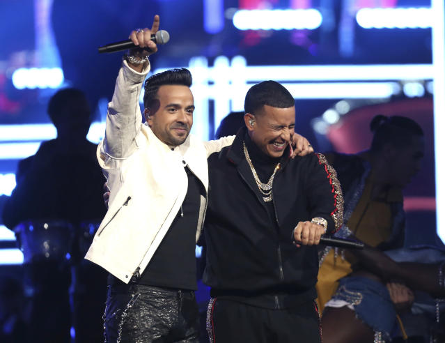 "Luis Fonsi, left, and Daddy Yankee perform ""Despacito."" (Photo by Matt Sayles/Invision/AP)"