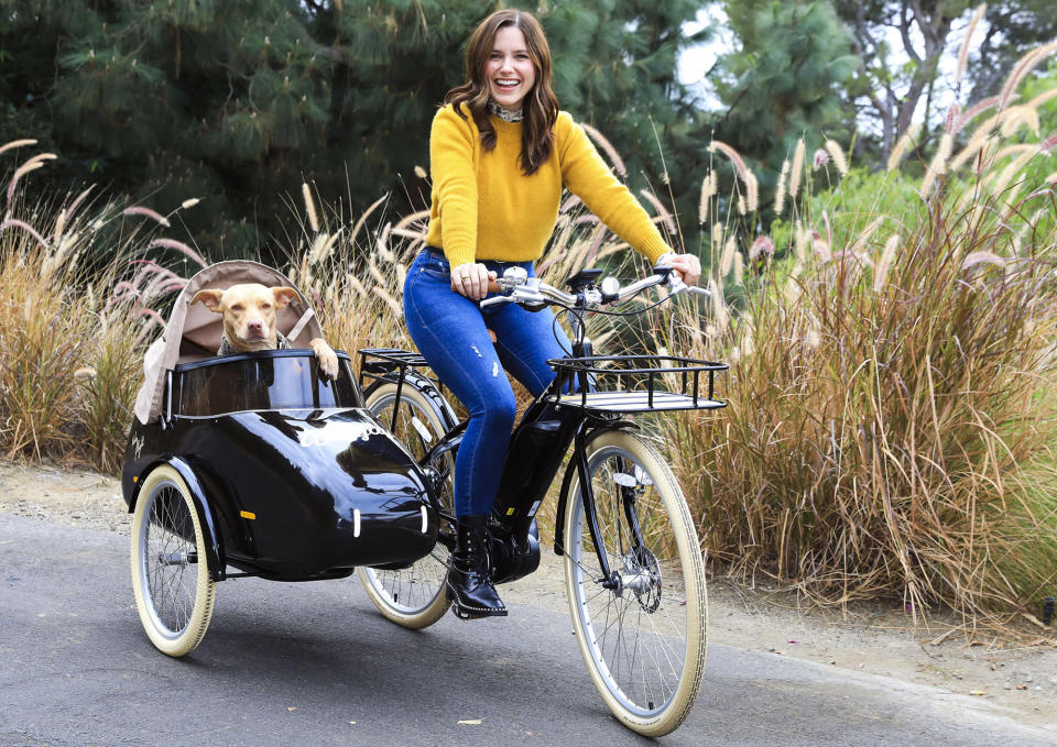 <p>Sophia Bush takes her dog Maggie for a ride on her new Bluejay electric bike on Tuesday in L.A. </p>