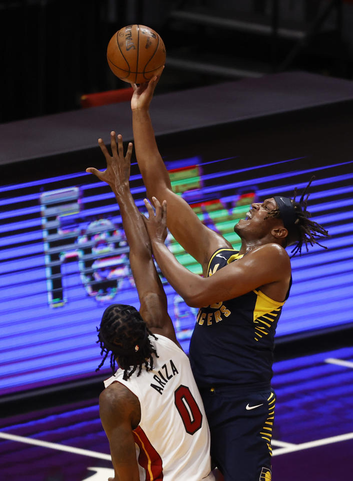 Indiana Pacers center Myles Turner (33) gets his shot off against Miami Heat forward Trevor Ariza (0) during the second half of an NBA basketball game, Sunday, March. 21, 2021, in Miami. (AP Photo/Joel Auerbach)