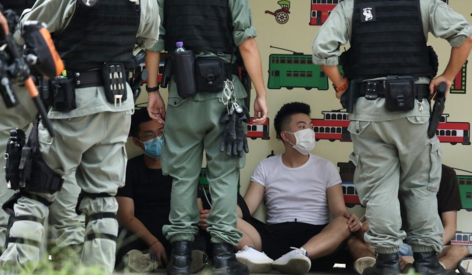 Anti-government protesters detained by police officers on July 1 in Causeway Bay. Photo: Xiaomei Chen