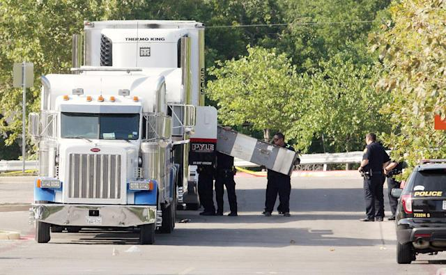 <p>Police officers work on a crime scene after eight people believed to be illegal immigrants being smuggled into the United States were found dead inside a sweltering 18-wheeler trailer parked behind a Walmart store in San Antonio, Texas, July 23, 2017. (Ray Whitehouse/Reuters) </p>