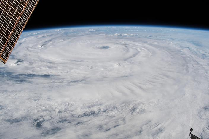 <p>Cameras outside the International Space Station captured a stark and sobering view of Hurricane Florence the morning of Sept. 12, 2018 as it churned across the Atlantic in a west-northwesterly direction with winds of 130 miles an hour. The National Hurricane Center forecasts additional strengthening for Florence before it reaches the coastline of North Carolina and South Carolina early Friday, Sept. 14. (Photo: NASA) </p>
