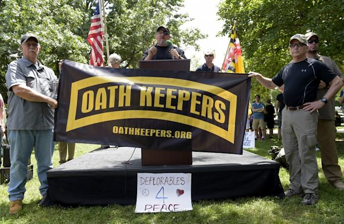 "Stewart Rhodes, founder of the citizen militia group known as the Oath Keepers, center, speaks during a rally outside the White House in Washington, Sunday, June 25, 2017. Rhodes was one of many speakers at the ""Rally Against Political Violence,"" that was to condemn the attack on Republican congressmen during their June 14 baseball practice in Virginia and the ""depictions of gruesome displays of brutality against sitting U.S. national leaders."" (AP Photo/Susan Walsh)"