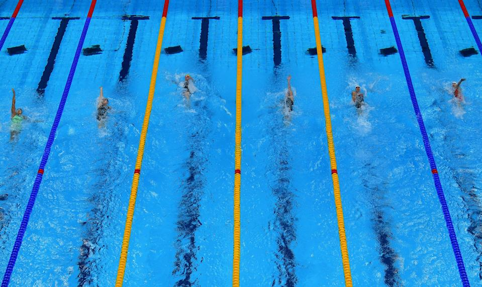 <p>An overview shows swimmers competing in a heat for the women's 200m backstroke swimming event during the Tokyo 2020 Olympic Games at the Tokyo Aquatics Centre in Tokyo on July 29, 2021. (Photo by François-Xavier MARIT / AFP) (Photo by FRANCOIS-XAVIER MARIT/AFP via Getty Images)</p>