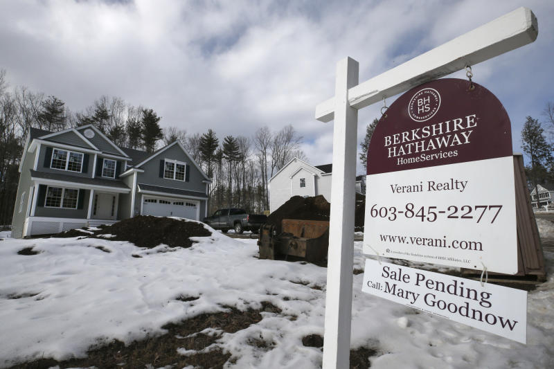 """In this Feb. 20, 2020, photo a """"Sale Pending"""" sign stands in front of a home still under construction in Auburn, N.H. On Wednesday, Feb. 26, the Commerce Department reports on sales of new homes in January. (AP Photo/Charles Krupa)"""