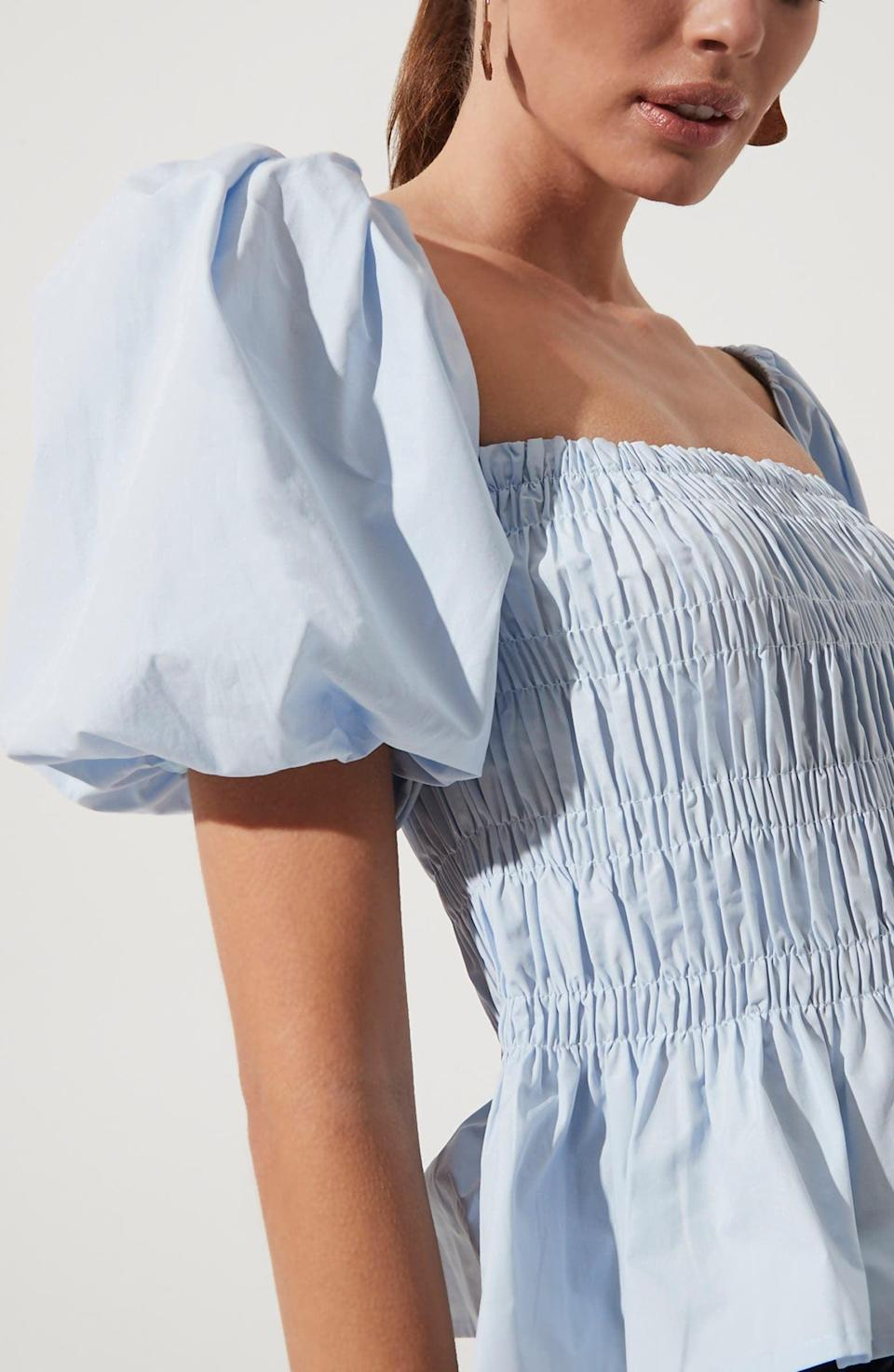 <p>The versatility of this <span>ASTR the Label Bubble Sleeve Smocked Blouse</span> ($65) makes it ideal for a daytime brunch or a dressy evening dinner.</p>